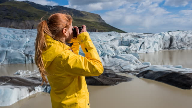tourist photographing glacier - climate research stock videos & royalty-free footage