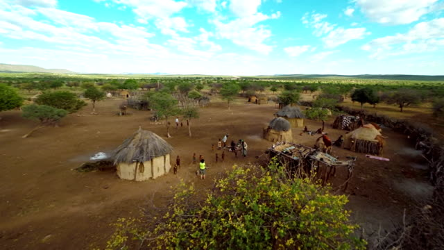 heli tourist photographing the himba tribe - village stock videos & royalty-free footage