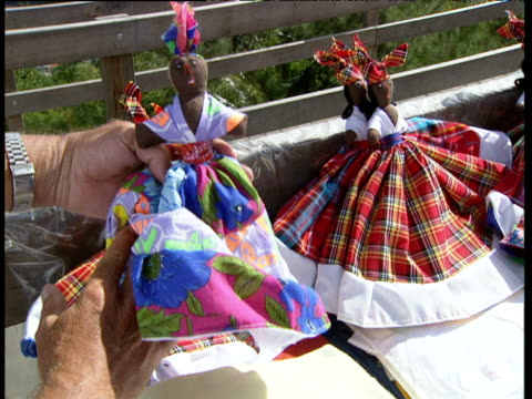 tourist plays with reversible multicolored and tartan doll windward islands - tartan stock videos & royalty-free footage