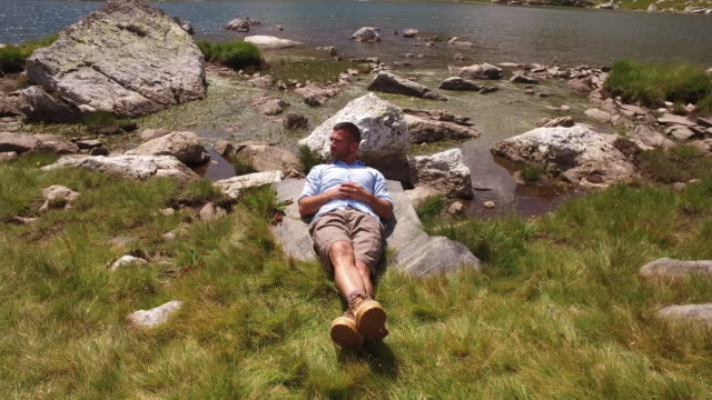 tourist relaxing in the mountain - legs crossed at ankle stock videos & royalty-free footage