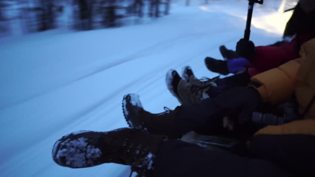 tourist riding on sledge on snowy landscape - sledge stock videos & royalty-free footage