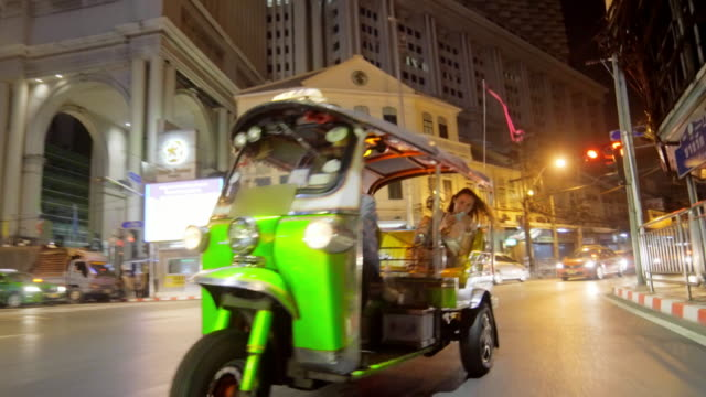 tourist riding tuk tuk in bangkok 4k - thailand stock videos and b-roll footage