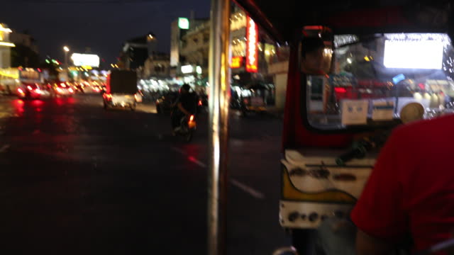 Tourist riding Tuk Tuk in Bangkok 4K