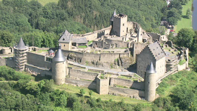ms aerial zi ds zo tourist roaming at bourscheid castle in village / luxembourg - luxembourg benelux stock videos & royalty-free footage