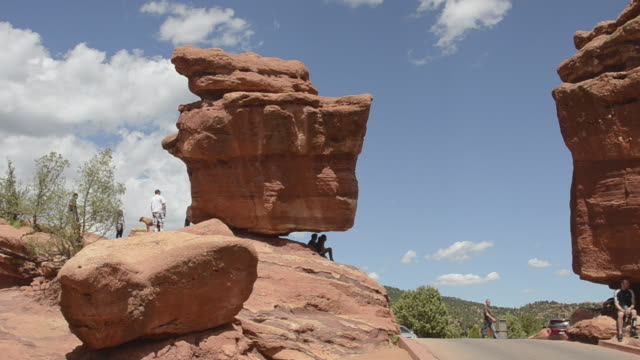 MS Tourist roaming at garden of the gods single rock called balanced rock / Colorado Springs, Colorado, United States