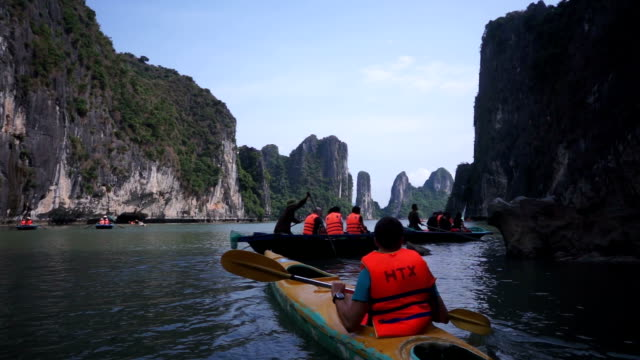 tourist rowing in halong bay - life jacket stock videos & royalty-free footage