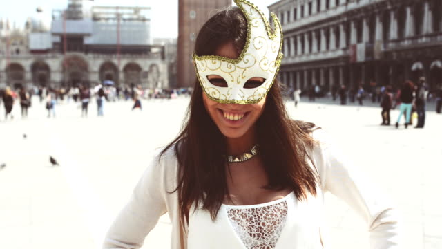 tourist smiling with venetian mask