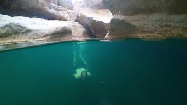 ws tourist swimming underwater in wadi shab - natural landmark video stock e b–roll