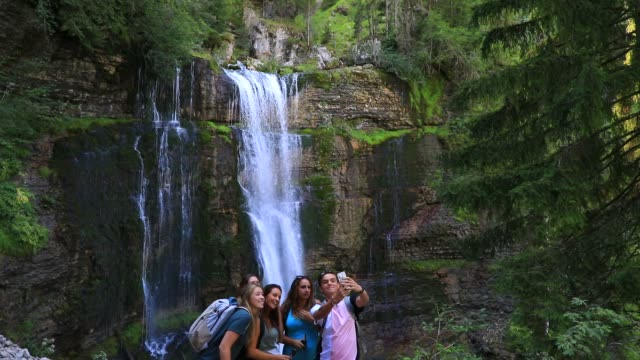 """tourist take a selfie near the waterfall at """"cirque de saint meme"""" a popular tourist site on september 3, 2020 in saint pierre d entremont, france.... - eco tourism stock videos & royalty-free footage"""