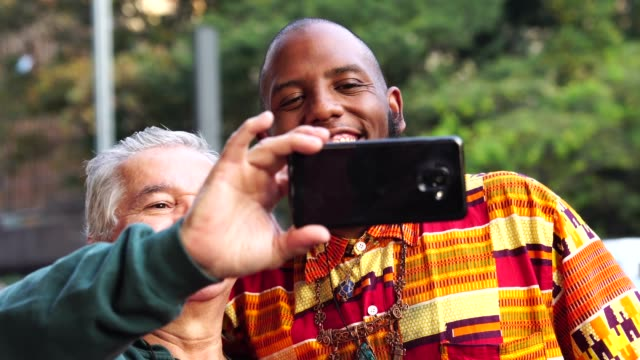 tourist taking a selfie with a afro descent rapper - pardo brazilian stock videos & royalty-free footage