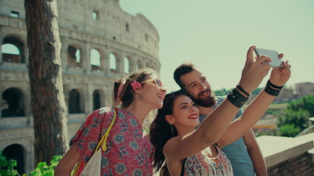 Tourist taking a travel selfie in Rome
