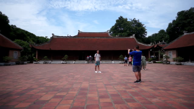 tourist taking photos at the expansive temple of literature - temple building stock videos & royalty-free footage
