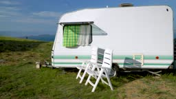 tourist trailer on the shore of a beautiful lake. caravan trailer of large size, equipped with all necessary household appliances to ensure the comfort of the traveler