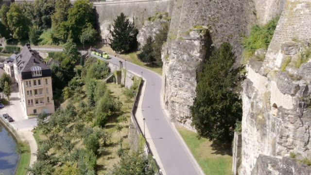 tourist train passing through luxembourg city - tourist train stock videos and b-roll footage