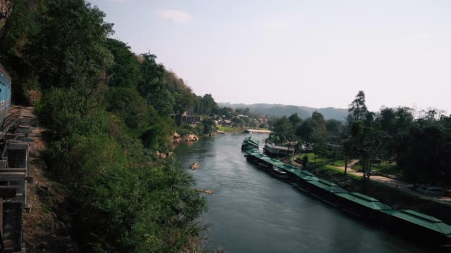 tourist travel by train on river kwai bridge of kanchanaburi, thailand. - rail transportation stock videos & royalty-free footage