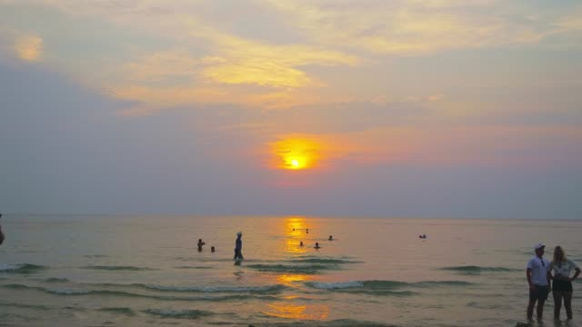 Tourist travel on clean Beautiful sea surface at sunset.
