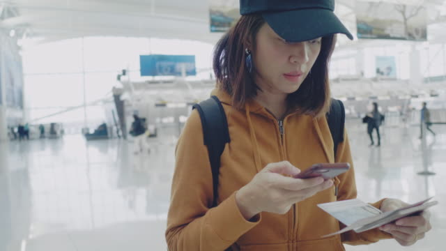 tourist using phone for check in online at airport - ticket counter stock videos & royalty-free footage