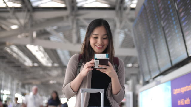 Tourist using phone for Check in online at airport