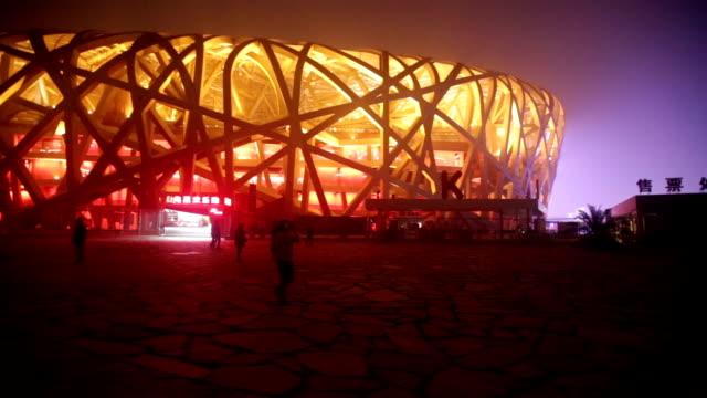 Beijing, Сhina - October 14, 2016: Tourist visit beijing bird nest stadium at night with lights on under haze pollution.