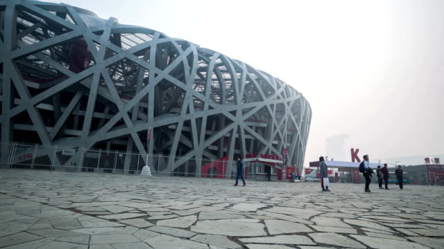 beijing, сhina - october 14, 2016: tourist visit beijing bird nest stadium under haze pollution. - bird's nest stock videos & royalty-free footage