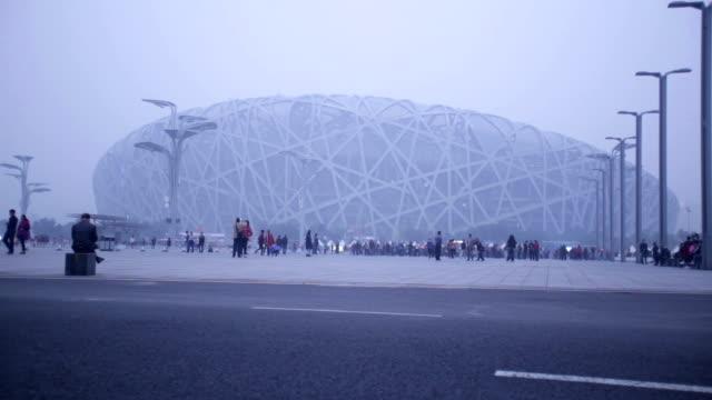 Beijing, Сhina - October 14, 2016: Tourist visit beijing bird nest stadium under haze pollution.