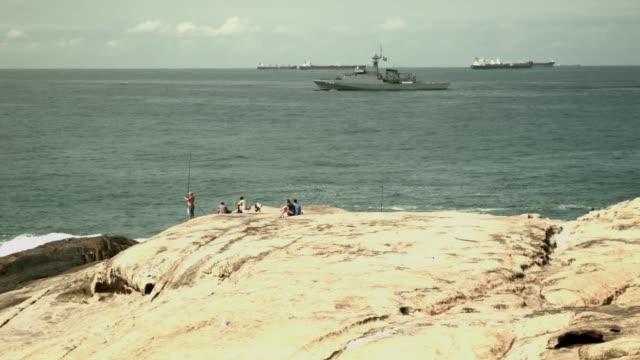 tourist visit impanema beach, shot on the 21st of june, 2014. - ゴールを狙う点の映像素材/bロール