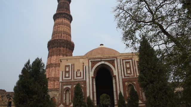 tourist visit to qutub minar, delhi, india. - sandstone stock videos & royalty-free footage