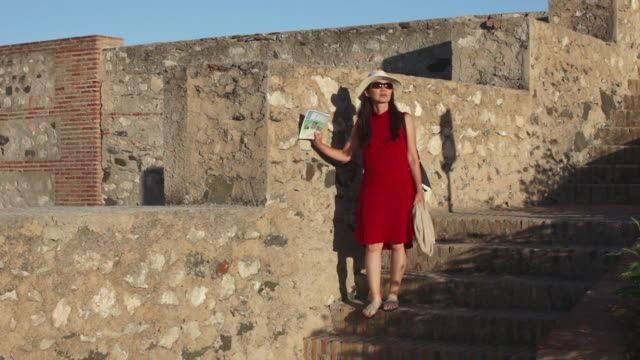 Tourist visits castle in Salobrena