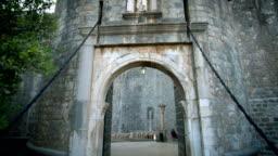 POV Tourist walk through Dubrovnik entrance gate.