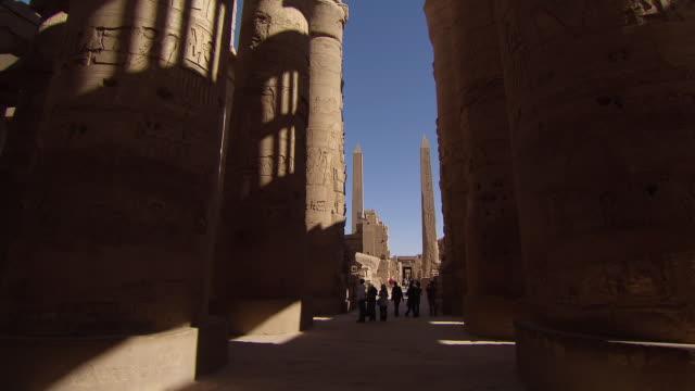 ms zo tourist walking at karnak temple / egypt - temples of karnak stock videos & royalty-free footage