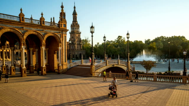 T/L Tourist walking at Plaza de Espana, Seville, Spain