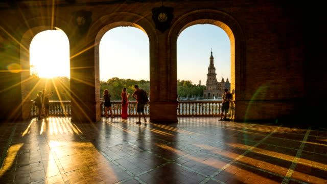 t/l tourist walking at plaza de espana, seville, spain - courtyard stock videos & royalty-free footage
