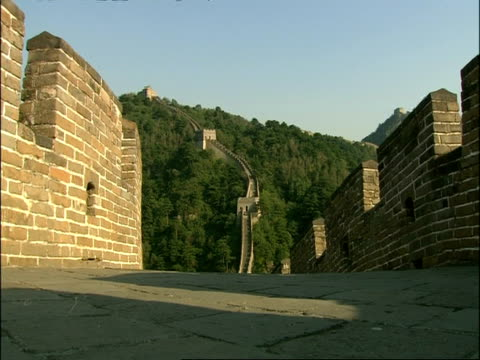 tourist walking away from camera, great wall of china, mutianyu, china - mutianyu stock videos & royalty-free footage