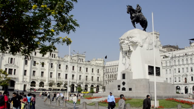 ms tourist walking in front of san martin square / lima, peru - animal representation stock videos and b-roll footage