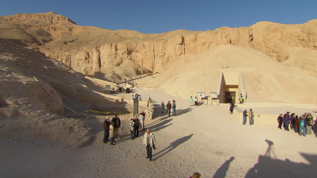 ws tl tourist walking near the tomb of tutankhamen / egypt - valley of the kings stock videos & royalty-free footage