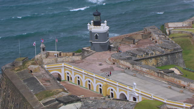 ms zo aerial pov tourist walking on morro castle / old san juan, puerto rico, united states - 16th century style stock videos and b-roll footage