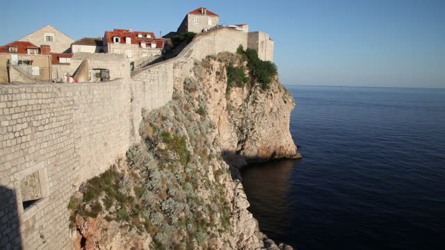 tourist walking on the walls of dubrovnik - circa 13th century stock videos & royalty-free footage
