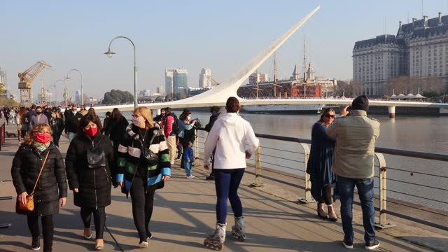 tourist walks in the exclusive waterfront of puerto madero on august 01 in buenos aires, argentina. - puerto madero stock videos & royalty-free footage