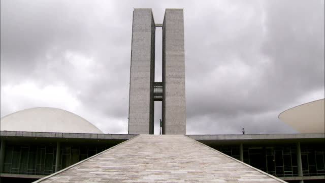 a tourist walks on the roof of brasilia's national congress building. available in hd. - brasilia stock videos and b-roll footage