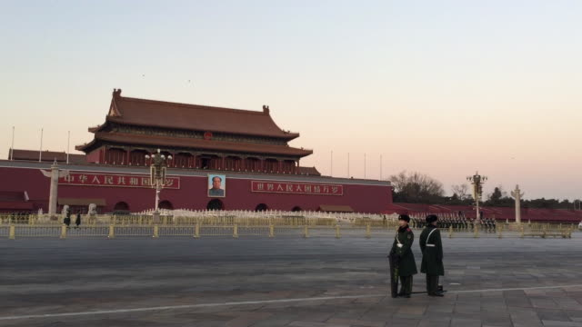 tourist watch flag lowering ceremony at famous tiananmen square on feb 13, 2017 in beijing, china. - lowering stock videos & royalty-free footage