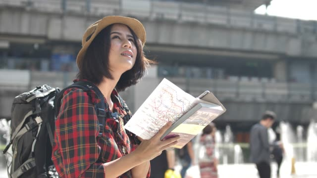Tourist with Map in city