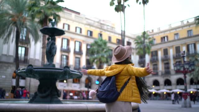 tourist woman at placa reial,barcelona - fountain stock videos & royalty-free footage