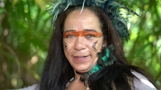 Tourist Woman Costumed as Indigenous in the Rainforest
