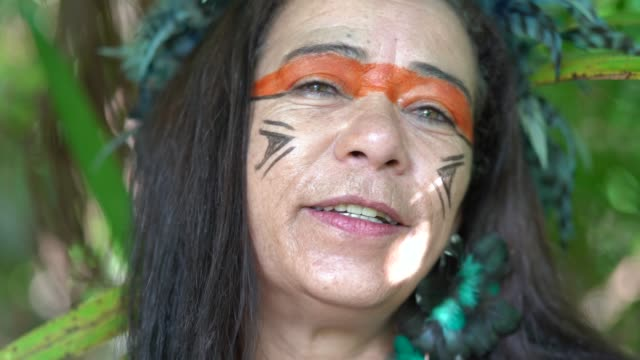 tourist woman costumed as indigenous in the rainforest - pardo brazilian stock videos & royalty-free footage