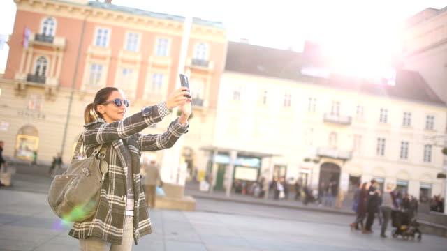 Tourist woman enjoys in the city
