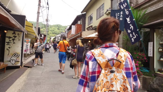 tourist woman exploring japan - randoseru stock videos & royalty-free footage