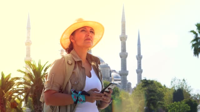 a tourist woman in istanbul speaks by phone. - istanbul province stock videos & royalty-free footage