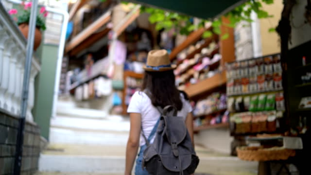 tourist woman in street market - hill stock videos & royalty-free footage