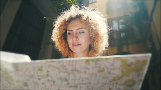 tourist woman looking on the city map. - tourist stock videos & royalty-free footage