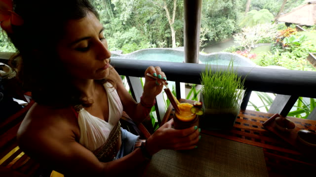 tourist woman relaxing with a cocktail at her hotel in bali - tourist resort stock videos & royalty-free footage